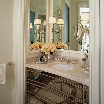 Andrew Skurman Architects - bathrooms - mirrored vanity, mirrored sink console, antiqued mirrored sink vanity, antiqued mirrored sink console, crystal hardware, crystal knobs, stone counter, stone countertop, oval undermount sink, mint julep cup, mint julep cup of roses, small silver tray, perfume tray, oval sink, brushed nickel faucet, mirror paneled vanity nook, brushed nickel sconces, brushed nickel traditional sconces, traditional bathroom, traditional powder room, built-in sink vanity, built-in vanity, vanity mirror, mirrored vanity area, mirrored vanity, antique mirrored vanity, mirrored bathroom vanity, antique mirrored bathroom vanity,
