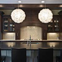 Blake Shaw Homes - kitchens - traditional kitchen, dark kitchen cabinetry, dark kitchen cabinets, dark stained kitchen cabinets, dark stained kitchen cabinetry, mini mosaic backsplash, mini mosaic backsplash tile, mosaic backsplash tile, espresso cabinetry, espresso cabinets, cabinet lighting, under cabinet lighting, paneled hood, cabinet fronted hood, custom hood, glass front cabinets, glass fronted cabinets, recessed lighting, pot lights, granite counters, granite countertops, built-in double oven, stainless steel double oven, undermount sink, sink in kitchen island, kitchen island, undermount stainless steel sink, gooseneck faucet, polished chrome gooseneck faucet, black granite, black granite counters, black granite countertops, black leather bar stools, leather bar stools, traditional kitchen cabinetry, traditional kitchen cabinets, beamed ceiling, ceiling beams, dark stained ceiling beams, Lotus Flower Chandeliers, , Viva Terra Lotus Flower Chandelier,