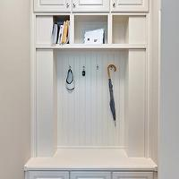 Blake Shaw Homes - laundry/mud rooms - mudroom, mud room, mudroom storage, mud room storage, mud room built-ins, mud room storage bench, mud room cubbies, mud room storage shelves, beadboard, coat hooks, crown molding, baseboards, gray walls, gray wall color, hardwood floors, dark hardwood floors, brushed nickel hardware, brushed nickel drawer pulls, raised panel cabinetry, raised panel cabinets, white mud room built-ins, beadboard bench,
