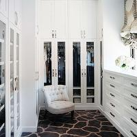 Jamie Herzlinger - closets - walk in closet, luxurious closet, luxurious walk in closet, floor to ceiling cabinets, closet cabinets, walk in closet cabinets, floor to ceiling built ins, floor to ceiling built in cabinets, glass doors, glass front doors, cabinet doors, glass cabinet doors, tufted chair, linen tufted chair, giraffe rug, built in jewelry cabinet, jewelry cabinet, accessories cabinet, built in accessories cabinet, gray roman shade,