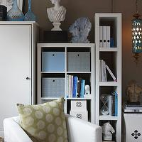 K Mathiesen Brown Design - dens/libraries/offices - taupe office, contemporary office, taupe walls, taupe office walls, white bookcase, ikea expedit bookcase, ikea expedit shelving unit, white garden stool, blue storage box, white lacquer box, horse head, white horse head, horse head statue, turquoise vase, turquoise blue vase, turquoise accents, turquoise blue accents, moroccan lantern, turquoise lantern, turquoise blue lantern, office lounge area, white chairs, green pillow,