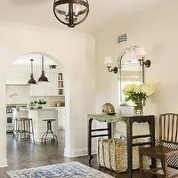 Christine Markatos Design - entrances/foyers - chic foyer, arched doorway, iron and glass lantern, banded globe lantern, iron banded globe lantern, glass banded globe lantern, iron globe lantern, glass globe lantern, runner, foyer runner, persian runner, blue runner, blue persian runner, white and blue persian rug, white and blue persian runner, venetian mirror, bronze sconce, foyer mirror, foyer, console table, foyer table, black console table, black foyer table, seagrass basket,