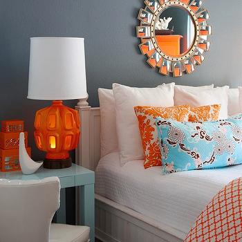 K Mathiesen Brown Design - bedrooms - orange and blue bedroom, orange and blue room, blue walls, blue bedroom walls, sunburst mirror, mirror over bed, mirror above bed, 4 poster bed, orange damask pillow, damask pillow, white and orange damask pillow, turquoise pillow, turquoise lumbar pillow, white and orange duvet, moorish tile duvet, moroccan tile duvet, quatrefoil dinner, orange moorish tile duvet, orange moroccan tile duvet, orange quatrefoil dinner, blue parsons desk, parsons mini desk, blue parsons desk, orange table lamp, orange lamp, orange lacquer box, stacked orange boxes,