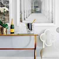 Style at Home - dining rooms - dining room bar, white gallery frames, antique brass console table, brass and glass console table, hickory chair, Alexandra Side Chair, quatrefoil chair, hickory quatrefoil chair, white quatrefoil chair, Suzanne Kasler Alexandra Side Chair,