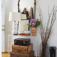 Erin Gates Design - entrances/foyers - chevron rug, stacked suitcases, vintage suitcases, decorative suitcases, vintage stacked suitcases, cb2 console tables, console table, acrylic console table, peekaboo clear console table, white gourd lamp, triple gourd lamp, white triple gourd lamp, antique mirror, brass mirror,