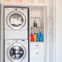 Lewis and Weldon - laundry/mud rooms - hidden laundry room, hidden laundry area, laundry area doors, pocket slide doors, slide back doors, slide back pocket doors, laundry closet, stackable washer and dryer, front loading washer and dryer, white front loading washer, white front loading dryer, organized laundry room, beadboard paneling, beadboard, laundry room shelves, small laundry room, laundry room, laundry room closet, closet laundry room,