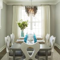 Martha O'Hara Interiors - dining rooms: gray walls, gray dinning room, gray wall color, hardwood floors, cotton sheers, linen sheers, ivory drapes, ivory curtains, gray and white rug, gray dining table, rectangular gray dining table, modern white dining chairs, white dinning chairs with gray seats, sash windows, double hung windows, double hung sash windows, beach place setting, beachy place settings, crown molding, baseboards, gray and white dining room, capiz shell chandelier, gray capiz shell chandelier, Large Rectangle Hanging Capiz Pendant - Gray,
