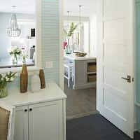 Martha O&#039;Hara Interiors - laundry/mud rooms - Benjamin Moore - Forget Me Not - mudroom, mud room, mud room built-ins, tiled floors, mudroom off kitchen, mud room off kitchen, office mud room, built-in desk, mud room storage, striped wallpaper, aqua blue striped wallpaper, beachy mud room, coastal mud room, beach inspired mud room, coastal inspired mud room, built-in bench, built-in mud room bench, built-in mudroom storage bench, turquoise mud room, turquoise mudroom, turquoise blue mud room, turquoise blue mudroom, turquoise cabinets, turquoise blue cabinets,