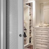 Buchman Photo - closets - walk-in closet, master closet, master bedroom closet, built-in closet system, chic closet, organized closet, glam closet, glamorous closet, acrylic shoe shelves, handbag cubbies, handbag shelves, purse shelves, purse cubbies, mirror fronted closet, mirror paneled closet, hardwood floors, built-in drawers, mirror backed vanity, closet system, custom closet system, pocket slide door, pocket door, pocket door to closet, pocket door with fretwork detail, crystal hardware, crystal knobs, closet pocket door,