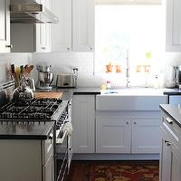 Handmaid Tales - kitchens - Glidden - Picket Fence - all-white kitchen, white kitchen, white kitchen cabinets, white cabinetry, white kitchen cabinetry, L-shaped kitchen, kitchen island, white subway tile, subway tiled backsplash, white subway tiled backsplash, stainless steel appliances, stainless steel oven, stainless steel hood, subway tile, black counters, black countertops, black silestone counters, black silestone countertops, martha stewart cabinets, recessed lighting, pot lights, farm sink, farmhouse sink, apron sink, spray faucet, modern spray faucet, schoolhouse lighting, flush mount schoolhouse pendant, hardwood floors, Restoration Hardware Duluth Hardware, Silestone Quartz Marengo Countertops, martha stewart cabinets, martha stewart kitchen cabinets,