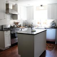Handmaid Tale - kitchens - Glidden - Picket Fence - all-white kitchen, white kitchen, white kitchen cabinets, white cabinetry, white kitchen cabinetry, L-shaped kitchen, kitchen island, white subway tile, subway tiled backsplash, white subway tiled backsplash, stainless steel appliances, stainless steel oven, stainless steel hood, stainless steel dishwasher, subway tile, black counters, black countertops, black silestone counters, black silestone countertops, martha stewart cabinets, recessed lighting, pot lights, farm sink, farmhouse sink, apron sink, spray faucet, modern spray faucet, schoolhouse lighting, flush mount schoolhouse pendant, stainless steel dishwasher, hardwood floors, Restoration Hardware Duluth Hardware, Silestone Quartz Marengo Countertops, martha stewart cabinets, martha stewart kitchen cabinets,