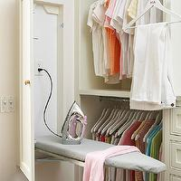 BHG - laundry/mud rooms - walk-in closet, master closet, clothes rails, double height clothes rails, built-in closet, built-in drawers, built-in drawer storage, fold-down ironing board, hidden ironing board, hide-away ironing board, closet ironing board, ironing board closet,
