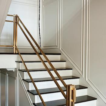 Paper City - entrances/foyers - brass hand rail, brass staircase rail, decorative wall moldings, contemporary staircase, staircase design,  Stunning