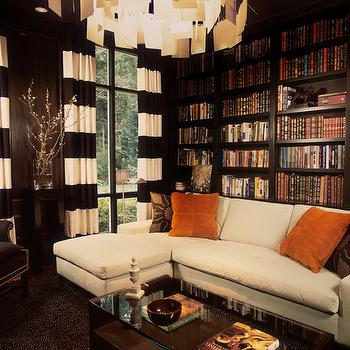NB Design Group - dens/libraries/offices - masculine dens, masculine office, wood paneled den, dark paneled den, dark wood paneled den, paneled library, dark paneled library, dark wood paneled library, masculine library, wood paneled library, black and white curtains, black and white drapes, black and white window panels, striped curtains, striped drapes, black and white striped curtains, black and white striped drapes, black and white striped window panels, zettel chandelier, built ins, builtin bookcase, built in cabinets, floor to ceiling bookcase, ivory sectional, sofa with chaise lounge, ivory sofa with chaise lounge, orange pillows, suede pillows, orange suede pillows, glass top coffee table, chocolate brown built ins, chocolate brown built in cabinets, chocolate brown bookcase, den, library, office, horizontal striped curtains, horizontal striped drapes, horizontal striped window panels, black and white horizontal striped curtains, black and white horizontal striped drapes, black and white horizontal striped window panels,