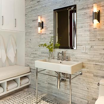 exquisite bathroom with floor to ceiling linear marble tile backsplash