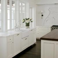 Ruard Veltman Architecture - kitchens - white cabinets with dark wood floors, white kitchen cabinets with dark wood floors, white cabinets with dark hardwood floors, white kitchen cabinets with dark hardwood floors, bank of windows, kitchen with no upper cabinets, farmhouse sink, dual dishwashers, kitchen with 2 dishwashers, paneled dishwasher, wood paneled dishwasher, gooseneck faucet, calcutta marble, calcutta marble countertop, calcutta marble backsplash, calcutta marble slab backsplash, kitchen island, butcher block kitchen island, butcher block island, coffered ceiling, kitchen coffered ceiling, coffered ceiling kitchen, bryant sconce, bronze bryant sconce,