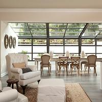 Gordon Gibson Construction - dining rooms - sunroom dining, sunroom dining room farmhouse dining table, whitewashed dining table, white farmhouse dining table, whitewash farmhouse dining table, mismatched dining chairs, french cafe chairs, french dining chairs, upholstered french chairs, gray wash floor, sunroom,