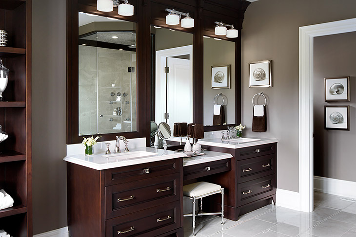 Jane Lockhart Interior Design - bathrooms - dark wood vanity, dark stained vanity, dark stained sink vanity, master bathroom, master bath, double sink, double sink vanity, his and hers sinks, drop-down vanity, drop-down make-up vanity, light stone counters, white counters, white countertops, polished chrome faucets, polished nickel hardware, chrome stool, chrome vanity stool, porcelain tiles, porcelain tiled floors, white porcelain tiled floors, taupe walls, taupe wall color, white trim, towel loop, shell art, seashell art, framed vanity mirror, undermount sinks, double sconces, double frosted glass sconces, Cross Cut White porcelain tiled floors, drop down vanity, drop down make up vanity, make up vanity, espresso cabinets, espresso bathroom cabinets, espresso vanity, espresso bathroom vanity,