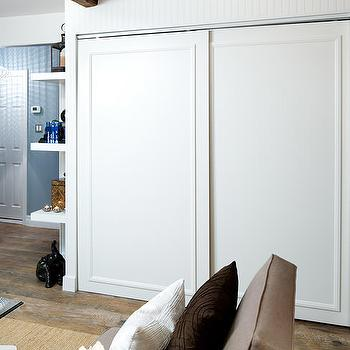 Hidden tv transitional living room house beautiful for Hidden sliding screen door