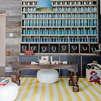 Eric Olson Design - boy&#039;s rooms - play room, playroom, boys play room, boys playroom, chalkboard wall, playroom chalkboard wall, play room chalkboard wall, chalkboard accent wall, 2 tone frames, 2 tone picture frames, white and gold frames, white and gold picture frames, blue cabinet, vintage cabinet, vintage blue cabinet, gold table lamp, gold teardrop lamp, vintage table, white poufs, white leather poufs, white moroccan poufs, dwell studio rug, draper rug, white and yellow rug, striped rug, white and yellow striped rug, floor to ceiling cabinet, floor to ceiling display cabinet, display cabinet, reclaimed wood cabinet, reclaimed wood display cabinet, salvaged wood cabinet, salvaged wood display cabinet, vintage light pendant, vintage blue light pendant, mason jars, painted mason jars, blue mason jars,