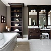 Jane Lockhart Interior Design - bathrooms - built-in shelves, ceiling height built-in shelves, built-in storage shelves, freestanding bath, freestanding tub, freestanding soaking tub, polished chrome faucet, sash windows, brown window blinds, dark wood vanity, dark stained vanity, dark stained sink vanity, master bathroom, master bath, double sink, double sink vanity, his and hers sinks, drop-down vanity, drop-down make-up vanity, light stone counters, white counters, white countertops, polished chrome faucets, polished nickel hardware, chrome stool, chrome vanity stool, porcelain tiles, porcelain tiled floors, white porcelain tiled floors, taupe walls, taupe wall color, white trim, towel loop, shell art, seashell art, framed vanity mirror, undermount sinks, double sconces, double frosted glass sconces, Cross Cut White porcelain tiled floors, drop down vanity, drop down make up vanity, make up vanity, espresso cabinets, espresso bathroom cabinets, espresso vanity, espresso bathroom vanity,