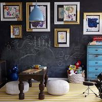 Eric Olson Design - boy&#039;s rooms - play room, playroom, boys play room, boys playroom, chalkboard wall, playroom chalkboard wall, play room chalkboard wall, chalkboard accent wall, 2 tone frames, 2 tone picture frames, white and gold frames, white and gold picture frames, blue cabinet, vintage cabinet, vintage blue cabinet, gold table lamp, gold teardrop lamp, vintage table, white poufs, white leather poufs, white moroccan poufs, dwell studio rug, draper rug, white and yellow rug, striped rug, white and yellow striped rug, floor to ceiling cabinet, floor to ceiling display cabinet, display cabinet, reclaimed wood cabinet, reclaimed wood display cabinet, salvaged wood cabinet, salvaged wood display cabinet, vintage light pendant, vintage blue light pendant, mini drum set, mason jars, painted mason jars,
