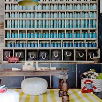Eric Olson Design - boy&#039;s rooms - play room, playroom, boys play room, boys playroom, white poufs, white leather poufs, white moroccan poufs, dwell studio rug, draper rug, white and yellow rug, striped rug, white and yellow striped rug, floor to ceiling cabinet, floor to ceiling display cabinet, display cabinet, reclaimed wood cabinet, reclaimed wood display cabinet, salvaged wood cabinet, salvaged wood display cabinet, vintage light pendant, vintage blue light pendant, mason jars, painted mason jars, blue mason jars, turquoise mason jars,