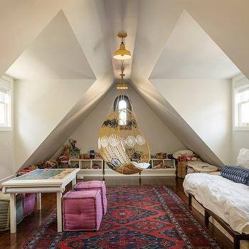 Sutro Architects - girl's rooms - attic, attic playroom, loft, loft playroom, vaulted ceilings, hardwood floors, red and blue ethnic rug, red and blue persian rug, craft table, coloring table, art table, green tufted cube pouf, pink tufted cube pouf, pink pouf, green pouf, day bed, toy storage, toy cubbies, swinging chair, nest chair, ceiling hung chair, ceiling mount chair, woven ceiling hung chair, white ruched bedding, white ruched bed linens, blue bolster pillow, blue bolster cushions, yellow pendants, pitched ceilings, playroom space, kids play space, play space, moroccan swing chair, swing chair,
