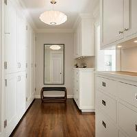 Sutro Architects - closets - all-white dressing room, white dressing room, dressing room, dressing room built-ins, closet system, built-in closets, walk-in closet, master closet, floor-to-ceiling closet system, closet storage, closed closet storage, hardwood floors, under cabinet lighting, undermount cabinet lighting, bench, floor length mirror, white closet system, polished nickel hardware, white built-in closet, bench, dressing room bench, crown molding, ceiling height closet cabinetry, George Nelson Saucer Pendant,