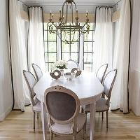 Janie Molster Design - dining rooms - french style dining room, white walls, white dining room, white oval dining table, traditional white oval dining table, louis dining chairs, french dining chairs, linen louis chairs, white cotton drapes with black trim, white cotton curtains with black trim, white drapes with black ribbon border, white curtains with black ribbon border, woven blinds, light woven blinds, iron chandelier, french iron chandelier, iron candelabra chandelier, light hardwood floors, hardwood floors, neutral dining room, tonal dining room, monochromatic dining room, ceiling medallion, white and black curtains, white and black drapes, white and black window panels,