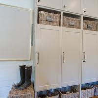 Abbey Construction - laundry/mud rooms - mudroom, mud room, mudroom storage, mudroom cabinetry, mudroom closets, mudroom cabinetry, mudroom cabinets, mudroom cubbies, woven basket, basket storage, built-in basket storage, chalkboard labels, chalkboard tags, iron hardware, built-ins, mudroom built-ins, mud room built-ins, hardwood floors, wood paneled walls, wood paneling, white wood paneling, white wood paneled walls, mudroom lockers, mud room lockers, mudroom lockers, mud room cubbies, mudroom cubbies,