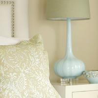 Janie Molster Design - bedrooms - cafe au lait walls, cafe au lait wall color, upholstered headboard with nailhead trim, green pillows, modern white nightstand, tall blue lamp, blue lamp with gray shade, green pillow, green foliage print pillow, blue table lamp, white nightstand, blue bowl, ivory headboard, ivory upholstered headboard with nailhead trim, turquoise lamp, turquoise blue lamp,