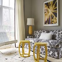 Janie Molster Design - living rooms - yellow and gray living room, gray walls, gray wall color, sisal rug, diamond patterned sisal rug, layered rugs, moroccan rug, moroccan wool rug, yellow side tables, yellow accent tables, modern white leather chair, modern tufted white leather chair, black and white sofa, black and white damask sofa, wool pillow, mongolian wool pillow, framed abstract photograph, purple and yellow abstract art, yellow geometric table lamp, yellow stools, yellow table lamp, ivory drapes with black trim, ivory curtains with black trim, ivory drapes with black border, ivory curtains with black border, floor length drapes, floor length curtains, crown molding, sash windows, double hung windows, double hung sash windows, Barcelona Chair, Taboret Stools, , black and white curtains, black and white drapes, damask sofa, Bungalow 5 Taboret Stool, Barcelona Chair,