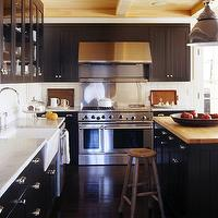 Robert Stilin - kitchens - black cabinets, black kitchen cabinets, beadboard cabinets, black beadboard cabinets, black beadboard kitchen cabinets, carrara marble countertops, white carrara marble counters, white carrara marble countertops, beadboard backsplash, white beadboard backsplash, beadboard kitchen, kitchen beadboard, perimeter countertop, apron sink, glass front top cabinets, black base cabinets, base cabinets, butcher block island, butcher block kitchen island, black kitchen island, beadboard kitchen island, black beadboard island, black beadboard kitchen island, black kitchen island with wood top, black kitchen island with butcher block countertop, rustic wood ceiling,
