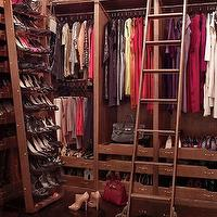 Architectural Digest - closets - luxurious closet, lux closet, luxurious walk in closet, celebrity closet, closet built ins, closet built in cabinets, built in cabinets, built ins, floor to ceiling built ins, sweater shelves, sweater cubbies, closet ladder, shoe racks, shoe shelves, shelves for shoes, shoe racks, built in shoe shelves, built in shoe racks, revolving shoe rack, sliding shoe rack, boot racks, revolving boot rack, sliding boot rack,