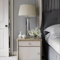 Sandra Nunnerley - bedrooms - gray bedroom, chic gray bedroom, gray walls, gray bedroom walls, bed canopy, gray bed canopy, bed curtains, gray bed curtains, bed panels, gray bed panels, 2 tone bed panels, 2 tone bed panels, gray headboard, gray tufted headboard, gray bed skirt, gray bedskirt, white and blue bedding, white and blue shams, white and blue sheets, white and blue duvet, two tone nightstand, 2 tone nightstand, mirrored table lamp, mirrored lamp, faceted lamp, faceted table lamp, mirrored faceted lamp, faceted mirrored lamp, gray carpeting,