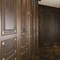Wendy Posard - closets - walk-in closet, traditional closet, traditional style closet, ceiling height closets, wooden closet doors, door molding, gold door medallion, hardwood floors, master closet, formal closet, formal walk-in closet, hardwood floors, parquet flooring, recessed lighting, pot lights, floor to ceiling cabinets, floor to ceiling built ins, floor to ceiling built in cabinets,