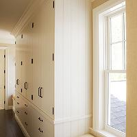 Wendy Posard - laundry/mud rooms - linen closet, hallway linen closets, hardwood floors, dark hardwood floors, built-in linen closets, second floor linen closet, hallway storage, hallway storage, built-in hallway closets, crown molding, iron hardware, built-in window seats, window seat in hallway, linen cabinets, built in linen cabinets,