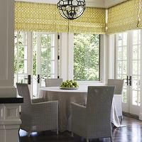 Wendy Posard - dining rooms - hardwood floors, dark hardwood floors, french doors, dining room, breakfast room, window blinds, roman blinds, yellow window blinds, yellow roman blinds, yellow and white geometric window blinds, yellow and white geometric roman blinds, skirted table, skirted dining table, contemporary woven chairs, gray woven chairs, crown molding, lantern pendant, iron and glass lantern, spherical iron and glass pendant, Kelly Wearstler Imperial Trellis Citrine, roman shades, trellis roman shades, imperial trellis roman shades, yellow trellis, yellow trellis roman shades,