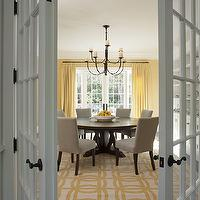 Wendy Posard - dining rooms - yellow dining room, yellow walls, yellow wall color, yellow dining room walls, yellow drapes, yellow curtains, yellow floor length drapes, floor length drapes, floor length curtains, hardwood floors, french doors, interior french doors, round dining room table, round dining table, parsons chairs, gray parsons chairs, transitional chandelier, iron chandelier, transitional iron chandelier, yellow and ivory rug, geometric rug, yellow and ivory geometric rug, yellow and gray dining room,