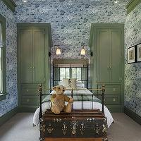 Wendy Posard - boy&#039;s rooms - wallpapered walls, blue wallpapered walls, boys bedroom wallpaper, whimsical wallpaper, vaulted ceiling, built-in cupboards, brass hardware, iron bed, boys bedroom, green and blue boys bedroom, vintage trunk, steamer trunk, vintage steamer trunk, plaid throw, blue and green plaid throw, frosted glass sconces, solider pillow, soldier print pillow, wall to wall carpet, crown molding, baseboards, window trim, green cupboards, green built-in cupboards, white duvet, recessed lighting, pot lights, whimsical boys room, whimsical boys bedroom,
