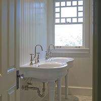 Wendy Posard - bathrooms - white bathroom, white beadboard, beadboard walls, beadboard paneled walls, beadboard wall paneling, white beadboard paneled walls, hexagonal marble tiled floors, hexagonal marble tiled floors, pedestal sink, gooseneck faucet, crystal door knob, craftsman window, Parisian Pedestal Sink, double pedestal sink, double parisian pedestal sink,