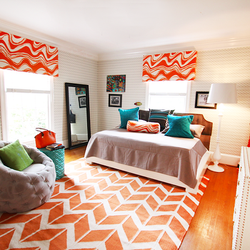 Lucy and Company - girl's rooms - hardwood floors, orange and white geometric rug, orange and white chevron rug, orange and white zigzag rug, tufted gray chair, green pillow, turquoise garden stool, brown headboard, daybed, orange and gray bedroom, orange and gray girls room, orange and gray girls bedroom, teal pillows, window valance, orange and white window valance, black floor mirror, white floor lamp, white dresser with nailhead trim, nailhead trim dresser, justin bieber, turquoise garden stool, tufted gray chair, button tufted chair, button tufted gray chair, gray coverlet, gray and white geometric wallpaper, gray and white wallpaper, gray and white modern wallpaper, orange and gray boys room, orange and gray boys bedroom, abada rug, , Jill Rosenwald Hand-woven Orange Abada Wool Rug,