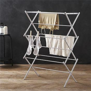 Storage Furniture - Large Folding Drying Rack in Laundry | Crate and Barrel - drying rack, laundry rack, steel drying rack, fold able drying rack,
