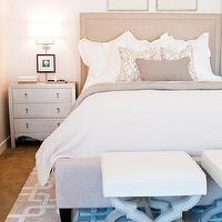 Ashley Winn Design - bedrooms - monochromatic bedroom, chic bedroom, white and tan bedroom, tan bedroom, art over bed, art above bed, art over headboard, art above headboard, beige headboard, beige linen headboard, tan headboard, tan linen headboard, beige linen bed, beige throw blanket, geometric pillows, white and tan pillow, white and tan geometric pillow, chains rug, tan chains rug, white and tan chains rug, geometric rug, white and tan rug, white and tan geometric rug, bedroom ottomans, ottomans at foot of bed, stools at foot of bed, x base stool, gray x base stool, crate and barrel sconce, gray nightstand, Accent Chest In Textured Champagne Silver, silver nightstand,