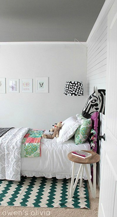 Owen's Olivia - girl's rooms - Benjamin Moore - Secret - Anthropologie Savannah Story Bust - Zebra, Urban Outfitters Zigzag Rug, eclectic girls room, eclectic girls bedroom, sweet girls room, sweet girls bedroom, decorators white, white wall panels, anthropologie zebra head, savannah story bust, savannah story bust zebra, decorative zebra head, paper mache zebra head, target nightstand, zigzag rug, teal zigzag rug, teal rug, teal chevron rug, chevron rug, urban outfitters rug, vintage bed, purple bed, girls bed, purple twin bed, twin purple bed, target bedding, white ruffle shams, white ruffle blanket, target ruffle sham, target ruffle blanket, target white ruffle sham, target white ruffle blanket, green and pink pillows, gray ceiling, painted ceiling, gray painted ceiling,