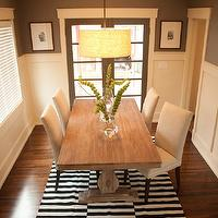 Ashley Winn Design - dining rooms - chocolate brown wall, chocolate brown dining room chocolate brown dining room walls, board and batten, board and batten walls, dining room board and batten, board and batten dining room, drum light pendant, drum chandelier, drum light pendant, world market dining table, trestle dining table, world market trestle dining table, provence dining table, parsons dining chairs, linen dining chairs, black and white rug, striped rug, black and white striped rug,