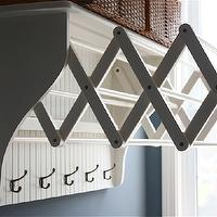 Sarah Macklem Interiors - laundry/mud rooms - wall mount accordion clothes dryer, laundry room, laundry room clothes dryer, clothes dryer, wall mount clothes dryer, wall mounted clothes dryer, wall mounted accordion clothes dryer, accordion clothes dryer, row of hooks, blue gray walls, laundry room paint, laundry room paint colors, blue gray paint, blue gray paint colors, bluish gray paint, bluish gray paint colors, laundry room paint, laundry room paint colors,