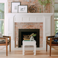 Ashley Winn Design - living rooms - brick fireplace, white fireplace mantle, fireplace mantle, original fireplace, original brick fireplace, fireplace millwork, mantle millwork, fireplace mantle millwork, styled fireplace, styled fireplace mantle, fireplace add ons, mid century modern chairs, brown leather chairs, vintage chairs, vintage leather chairs, white accent table, chinoiserie table, white chinoiserie table, light wood floors,