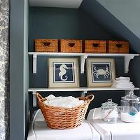 Sarah Macklem Interiors - laundry/mud rooms - blue gray walls, laundry room paint, laundry room paint colors, blue gray paint, blue gray paint colors, bluish gray paint, bluish gray paint colors, laundry room paint, laundry room paint colors, stacked shelves, laundry room shelves, laundry room baskets, laundry oom storage, beachy art, beach art, blue seahorse art, blue seahorse print, blue crab art, side by side washer and dryer,